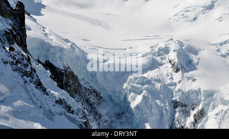Glacier seen from top of Aiguille du Midi below Mont Blanc - Stock Photo