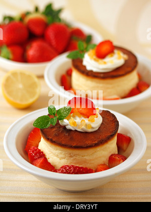 Cheese tart with lemon and strawberries. Recipe available. - Stock Photo