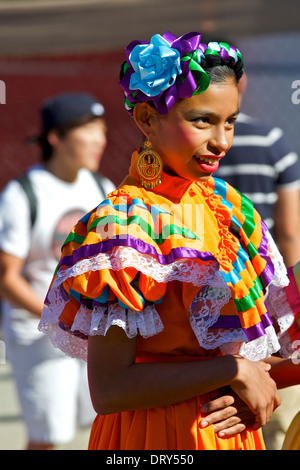 Girl in Traditional Costume prepare to appear in the Chinese New Year Parade, Chinatown, Los Angeles. - Stock Photo