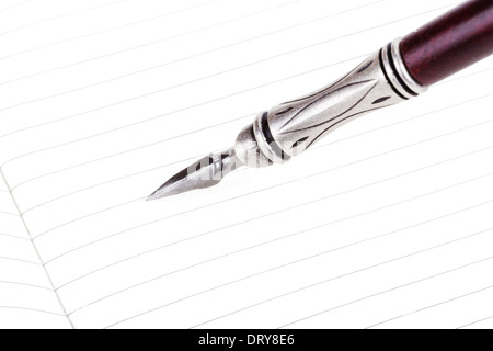 Writing in a text book with luxury retro ink pen isolated Stock Photo