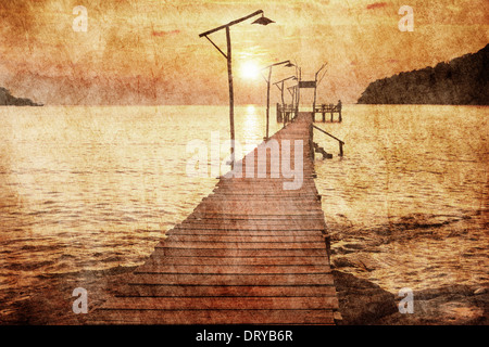 Sunset over the sea in grunge and retro style - Stock Photo