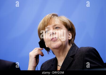 Berlin, Germany. Februar 04th, 2014. German Chancellor Angela Merkel welcomes the Turkish Prime Minister Recep Tayyip - Stock Photo