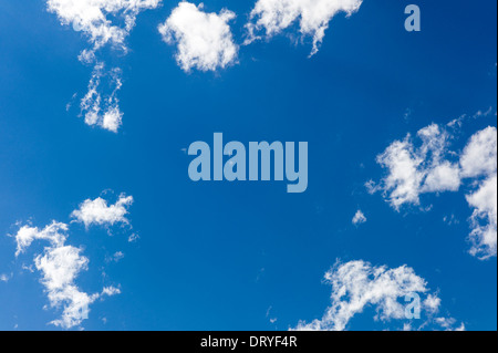 Wispy white clouds against a clear blue Colorado sky - Stock Photo