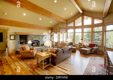 The interior of a modern log cabin depicting luxury amid a rustic decor.