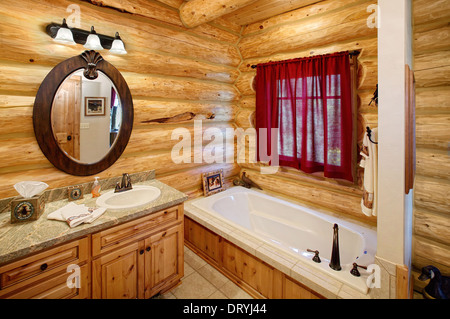 The bathroom interior in a modern log cabin. It features rustic western decor.