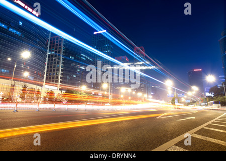 light trails on the street in beijing - Stock Photo