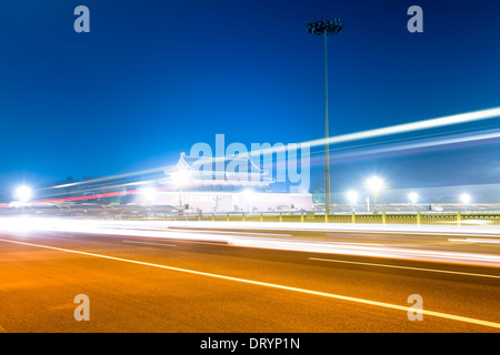 light trails on square in beijing - Stock Photo