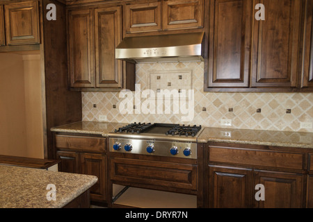 Unfinished Kitchen in new custom home under construction - Stock Photo