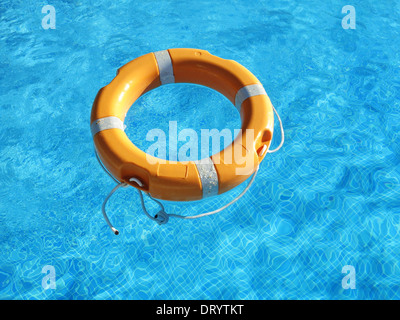 Lifebelt in swimming pool - Stock Photo