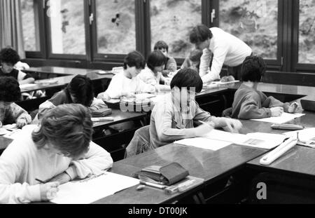 The picture shows teaching at a secondary school in chemistry, mathematics, and dry with girls and boys  . - Stock Photo