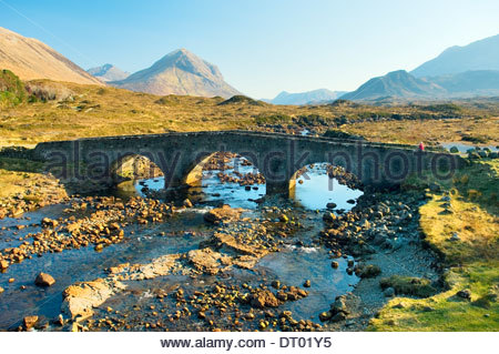 Isle of Skye, Inner Hebrides, Scotland. Looking to the Cuillin Hills over the River Sligachan and old stone bridge - Stock Photo