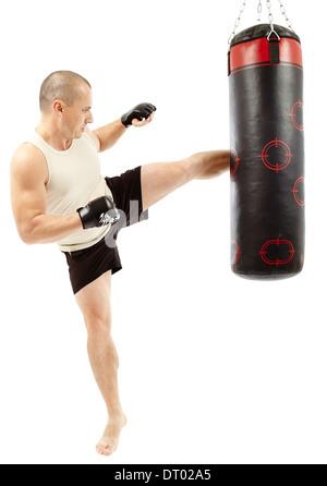 Boxer kicking the punching bag isolated on white - Stock Photo