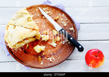 rustic apple pie on a tray, two slices, foode - Stock Photo