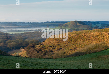 The view from the North Downs escarpment with Summerhouse hill on the right, with Folkestone Eurotunnel on the left. - Stock Photo