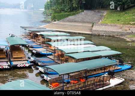 China, Yangshuo County, Bamboo rafts on the Yulong River Karst formations - Stock Photo