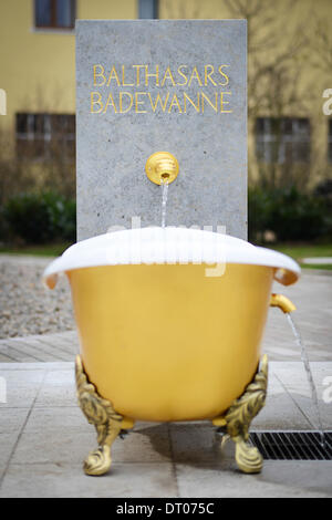 Randsacker, Germany. 05th Feb, 2014. Water flows through the new 'bathtub fountine' at the Place de Vouvray in Randsacker, - Stock Photo
