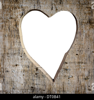 Heart shape carved into a wooden plank, white copy space - Stock Photo