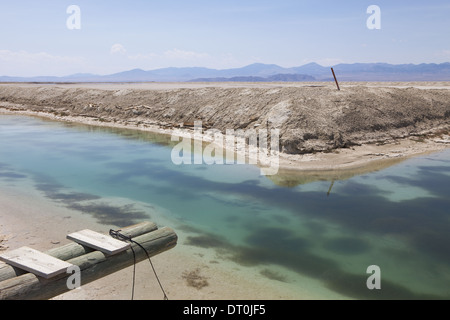 Bonneville Salt Flats Utah USA Industrial canal and water in the desert walkway - Stock Photo