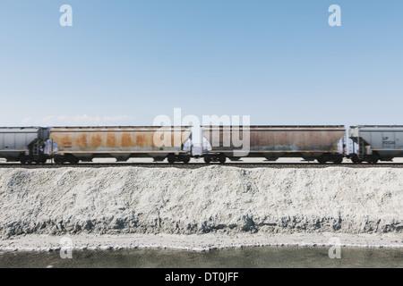 Bonneville Salt Flats Utah USA goods train in the desert on railway tracks - Stock Photo
