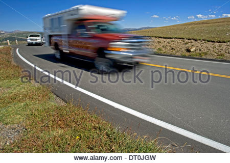 Tourists driving truck camper on the Trail Ridge Road in the Rocky Mountain National Park, Colorado, USA - Stock Photo