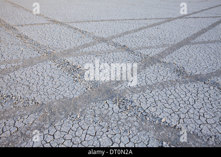 Black Rock Desert Nevada USA Tyre marks tracks in the playa salt pan surface - Stock Photo