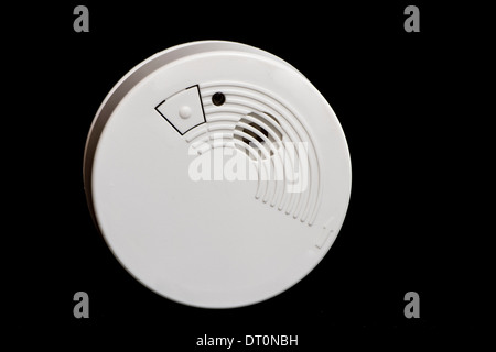 Fire safety with a smoke detector - Stock Photo