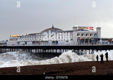 Brighton, Sussex. UK. 5th February 2014. Brighton Pier takes a battering from high seas during gale force winds - Stock Photo
