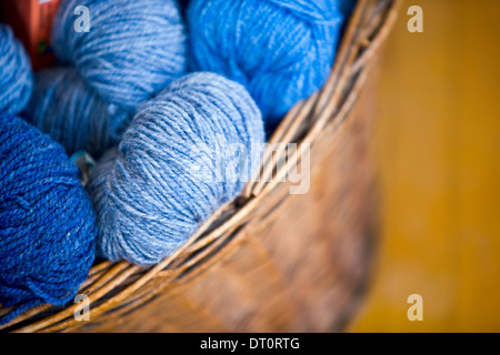 Wicker basket of  yarn wool skeins - Stock Photo