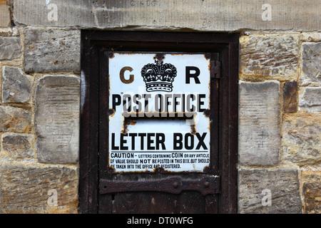 Historic Georgian Royal Mail post box  in sandstone wall, Penshurst , Kent , England - Stock Photo