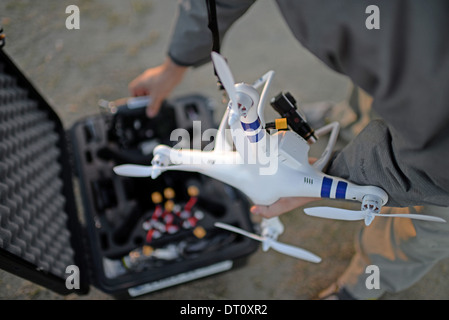 Young man flying Phantom Drone outdoors - Stock Photo