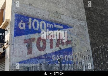 Old-style, vintage, painted Total petrol advertisement on wall in Lyon, France - Stock Photo