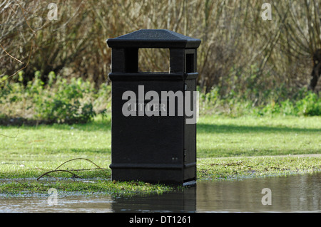 Litter bin and rising floodwater near River Great Ouse, Bedford, UK - Stock Photo