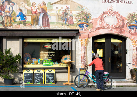 Artisan food shop selling bread and cheese in the village of Oberammergau in Bavaria, Germany - Stock Photo
