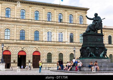 Tourist photographs statue of Maximillian Iosepho, King of Bavaria by the Residenz in Munich, Bavaria, Germany - Stock Photo