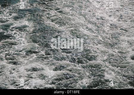 Seattle Washington USA Wake from passenger ferry on water near Seattle - Stock Photo