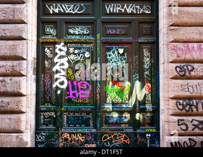 Graffiti sprayed on doorways in Trastevere, Rome, Italy. - Stock Photo