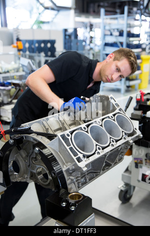 Mercedes-AMG engine production factory in Affalterbach, Germany - engineer checks engine block of 6.3 litre V8 engine - Stock Photo
