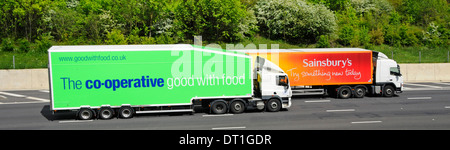 Sainsburys supermarket lorry being overtaken by Co op food supply chain store delivery hgv truck & articulated trailer - Stock Photo