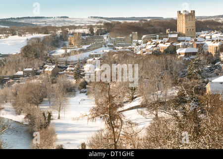 Richmond North Yorkshire bright lit snow scene showing the Castle, Town, River Swale and The Batts - Stock Photo