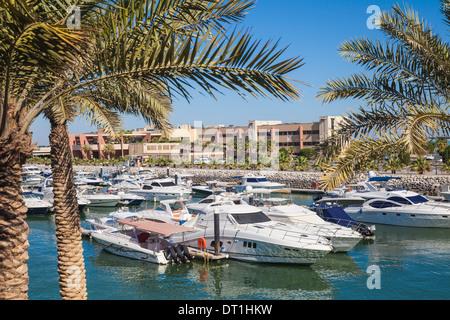 Marina Hotel overlooking Yacht Club on Arabian Gulf Street, Salmiya, Kuwait City, Kuwait, Middle East - Stock Photo