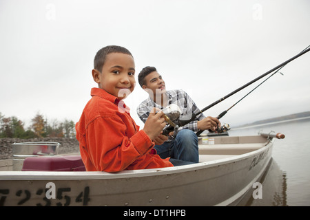A day out at Ashokan lake Two boys fishing from a boat - Stock Photo
