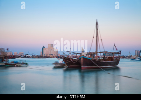 Boats in Doha Bay and Museum of Islamic Art, Doha, Qatar, Middle East - Stock Photo