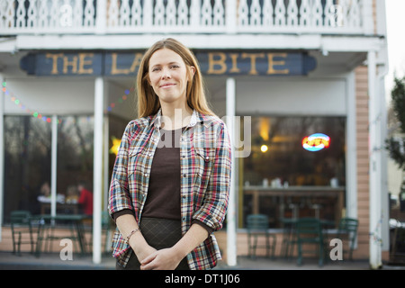 A coffee shop and cafe in High Falls called The Last Bite A woman standing outside a high street cafe - Stock Photo