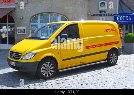 yellow dhl mercedes benz delivery van parked up outside best western hotdhl
