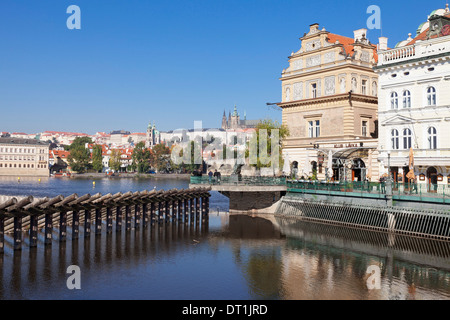 View over the River Vltava to Smetana Museum, Charles Bridge and the Castle District, Prague, Bohemia, Czech Republic, - Stock Photo