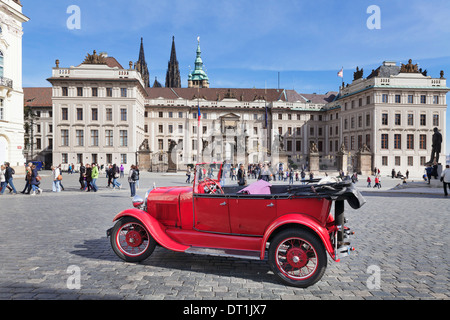 Red Oldtimer sightseeing, Hradcany Square, Castle Hradcany and St Vitus cathedral, UNESCO Site, Prague, Czech Republic - Stock Photo