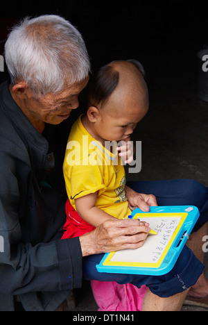 Grandfather and  child, Dong village of Zhaoxing, Guizhou Province, China, Asia - Stock Photo