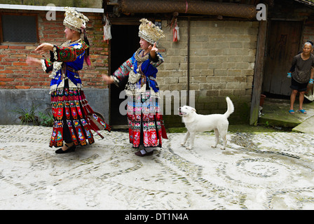 Miao girls in traditional costume and silver headdresses, Skirt Miao, Xijiang village, Guizhou Province, China, - Stock Photo
