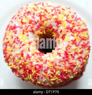White iced ring donut, London - Stock Photo