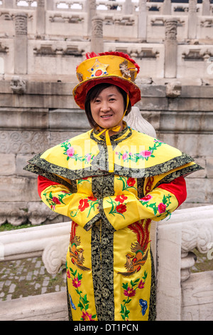 Young sing woman photographed in Traditional Chinese dress or Manchu from the Qin DYNASTY costume as seen at the - Stock Photo